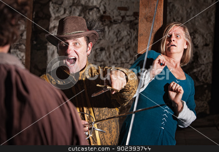 Yelling Sword Fighter with Lady stock photo, Yelling medieval sword fighter in front of scared woman by Scott Griessel