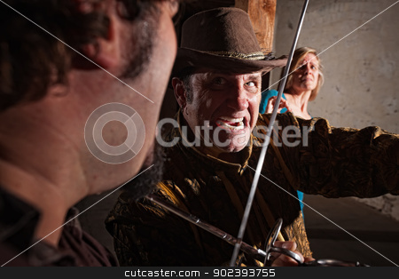 Close Up Sword Fight stock photo, Sword fight close up with afraid woman in background by Scott Griessel