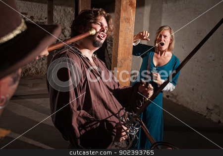 Swordsman Hit with a Mace stock photo, Swordsman is hit with a mace during fight as woman screams by Scott Griessel