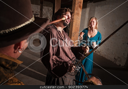 Woman Watches Swordsman Get Hit stock photo, Sympathetic lady watches man get hit by mace in medieval battle by Scott Griessel