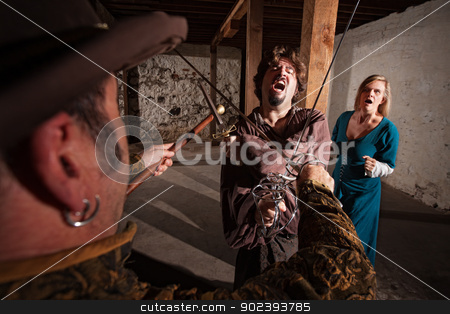 Yelling Swordfighter Attacking stock photo, Renaissance hero yelling in sword fight with lady behind him by Scott Griessel