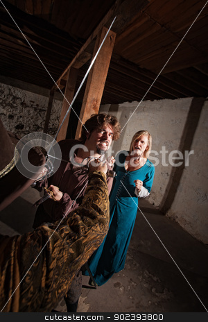 Swashbuckler Stricking Down Enemy stock photo, Sword fighter with clenched teeth aggressively attacking opponent by Scott Griessel