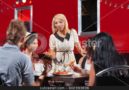 Diverse Friends Eating Together stock photo, Diverse group of friends eating pizza slices from food truck by Scott Griessel