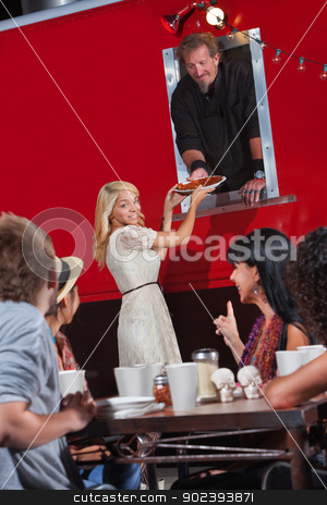 Picking Up Pizza Order stock photo, Pretty young woman picking up pizza order at food truck by Scott Griessel