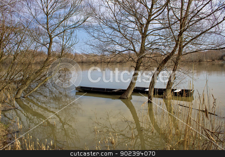 Wooden boats on Drava River stock photo, Wooden boats on Drava River, Podravina, Croatia by xbrchx