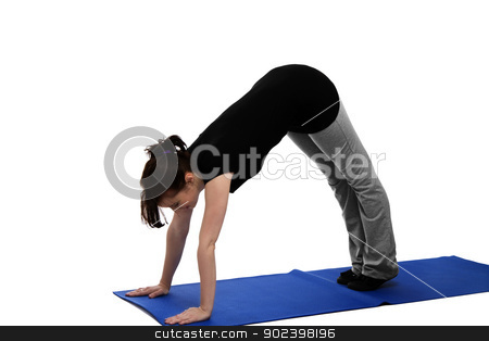 young woman exercising yoga on blue mat stock photo, young woman exercising yoga on blue mat by Rob Stark