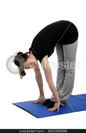 young woman exercising yoga placing hands on floor stock photo, young woman exercising yoga placing hands on floor by Rob Stark