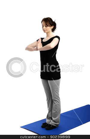 young woman exercising yoga pressing palms on each other stock photo, young woman exercising yoga pressing palms on each other by Rob Stark