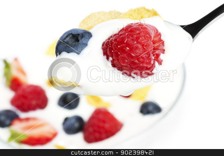 spoon with yogurt blueberry and a raspberry and cornflakes over a dessert on white background stock photo, spoon with yogurt blueberry and a raspberry and cornflakes over a dessert on white background by Rob Stark