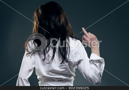 young woman from back showing the middle finger stock photo, young woman from back showing the middle finger by Rob Stark