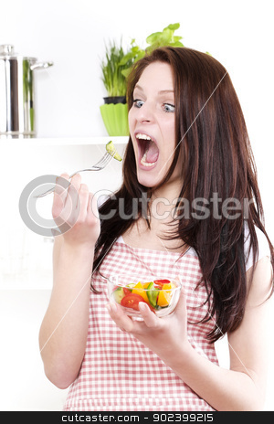 funny woman with wide open mouth and eyes  eating salad stock photo, funny woman with wide open mouth and eyes  eating salad by Rob Stark