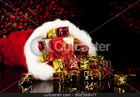 christmas presents falling from santa's hat on black background stock photo, christmas presents falling from santa's hat on black background by Rob Stark