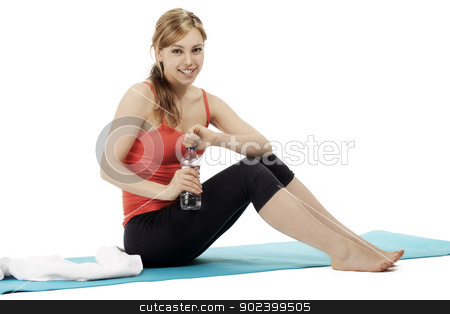 young cute fitness woman making a fitness break on white background stock photo, young cute fitness woman making a fitness break on white background by Rob Stark