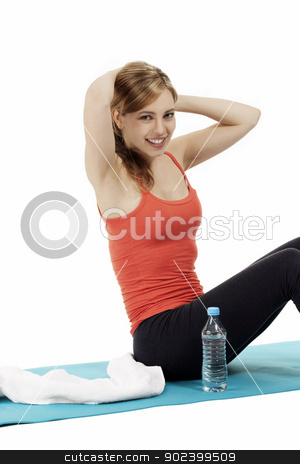 young happy fitness woman exercising on a mat with water aside on white background stock photo, young happy fitness woman exercising on a mat with water aside on white background by Rob Stark