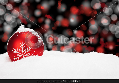 red christmas ball in snow with abstract background lights stock photo, red christmas ball in snow with abstract background lights by Rob Stark