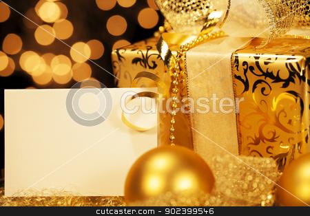 golden christmas present with christmas balls and a gift card stock photo, golden christmas present with christmas balls and a gift card by Rob Stark
