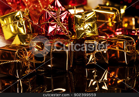 many small colorful christmas presents on black stock photo, many small colorful christmas presents on black by Rob Stark