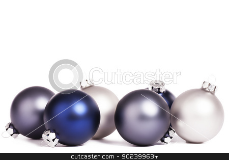 some silver and blue christmas balls on white background stock photo, some silver and blue christmas balls on white background by Rob Stark