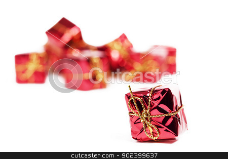 small red christmas present in front of others on white background stock photo, small red christmas present in front of others on white background by Rob Stark