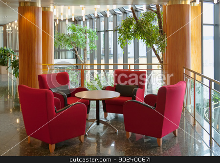 lobby stock photo, the hotel lobby with a magnificent red chairs by Ruslan Kudrin