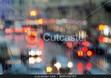 lights of the city at night through a wet glass stock photo, lights of the city at night through a wet glass. by Ruslan Kudrin