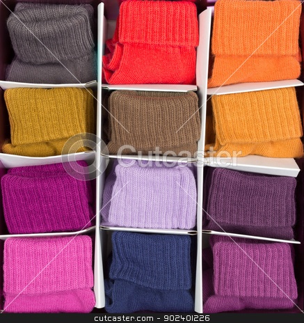 box of colored clothing stock photo, box of colored socks in cells by Ruslan Kudrin