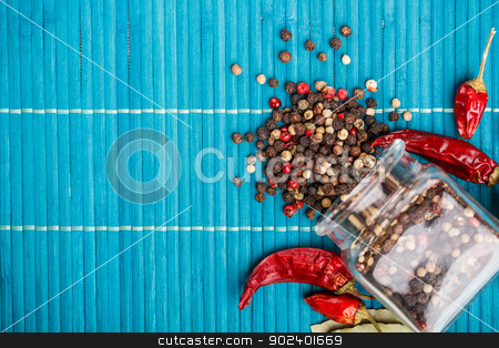 Mixed peppercorns stock photo, Mixed peppercorns in a glass bottle  by Grafvision