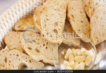 Tray of Fresh Made Sourdough Bread with Garlic Cloves stock photo, Tray of Fresh Made Sourdough Bread with Garlic Cloves on a Serving Table. by Andy Dean
