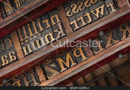 typesetter drawers stock photo, vintage typesetter drawers with letterpress wood type printing blocks by Marek Uliasz