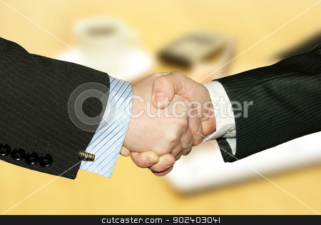 handshake  stock photo, Men handshake over paper and pen by Vitaliy Pakhnyushchyy