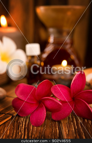Spa treatment setting stock photo, Spa treatment setting with frangipani ,pure essential oil and burning candle. by szefei