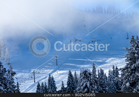 Ski School in the Fog Chairlifts at Snoqualme Pass Washington stock photo, Sking Chairlifts and Ski Class in the Fog on Snow Mountain at Snoqualme Pass Washington. by William Perry