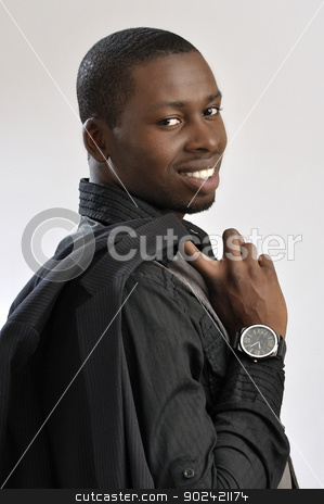 Handsome business man stock photo, Portrait of young successful fashionable businessman holding jacket over shoulder on grey background by Chad Zuber