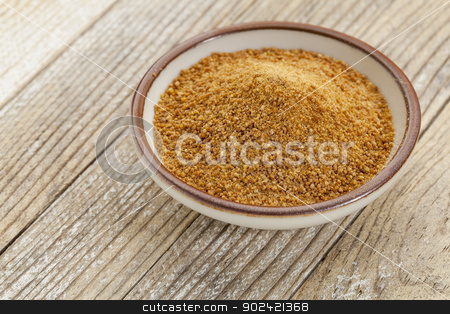 coconut palm sugar stock photo, small ceramic bowl of unrefined coconut palm sugar against a white painted grunge wood background by Marek Uliasz