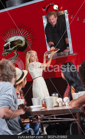 Chef Gives Order to Customer stock photo, Young woman handed pizza order by canteen chef by Scott Griessel