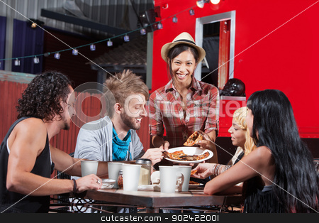 Late Night Snack at Food Truck stock photo, Friends enjoying pizza for late night snack by Scott Griessel