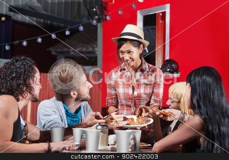 Friend Sharing Slices of Pizza stock photo, Smiling Asian woman sharing pizza slices with friends at food truck by Scott Griessel