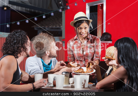 Lady Serving Pizza Outdoors stock photo, Cute Asian woman serving pizza to diners outside by Scott Griessel