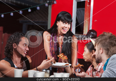 Four Happy People Eating Pizza stock photo, Group of four happy people eating pizza outside by Scott Griessel