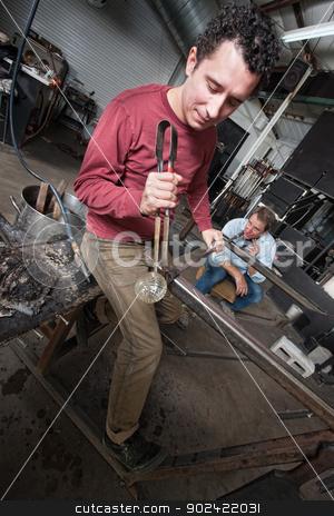 Two Men Working on Glass Art stock photo, Two European men creating fine art glass object by Scott Griessel