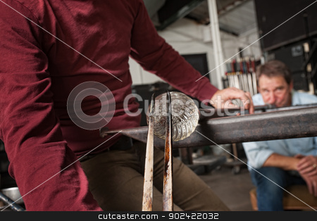 Men Creating Clear Glass Object stock photo, Man blowing into pipe for clear glass object by Scott Griessel
