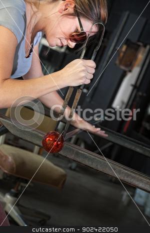 Worker Finishing Glass Object stock photo, Serious industrial artist finishing glass art object by Scott Griessel