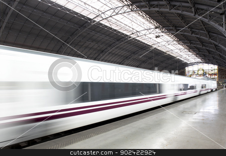 Railway station with train stock photo, Railway station with train in movement horizontal by ABBPhoto