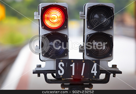 Railway traffic lights stock photo, Railway traffic lights on out of focus background by ABBPhoto