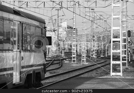 Railway station stock photo, Railway station with electric system transmission systems black and white by ABBPhoto