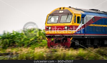 thai train moving on track stock photo, colorful thai train moving on track through forest by moggara12