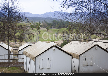 Safari Tents Overlooking the Plains stock photo, Several Safari Tents Overlooking the Plains. by Andy Dean