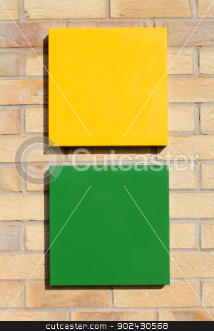 Blank signs on brick wall stock photo, Black green and yellow signs on brick wall with copy space. by Martin Crowdy