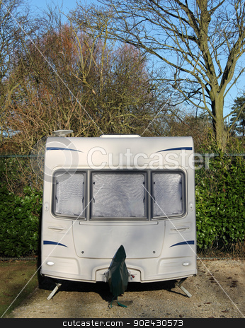 Caravan in countryside stock photo, Front view of white caravan in the countryside. by Martin Crowdy