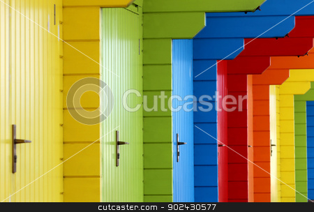 Colorful wooden beach chalets stock photo, Row of colorful wooden beach chalet doors. by Martin Crowdy
